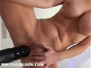 Busty cougar Heather fills her pussy with giant dildo