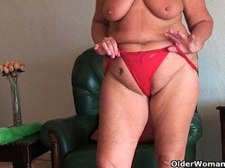 Chubby granny with saggy big tits and plump ass spreads her pussy