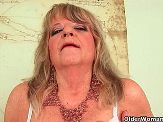 Grandmother with large breasts pushes huge anal dildo inside