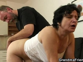 She gets her old hairy hole filled up with two cocks